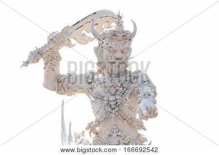 Pointing Yaksha or Giant from Thai-Buddhist Myth in Front of Hell Gate. A Sculpture in Wat Rong Khun or White Temple Chiang Rai Thailand. Clear Background.