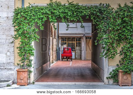 Three-wheeler car in a courtyard in Tuscany Italy