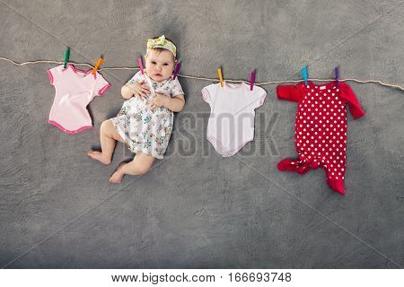 Baby and clothes hanging on the clothesline.