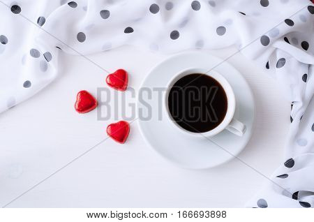 St Valentines day background - cup of coffee heart shaped candies with frame of chiffon polka dot scarf, St Valentines day still life