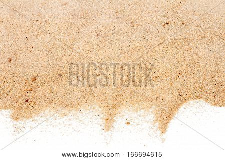 Pile of yellow sand isolated on white background selective focus at center
