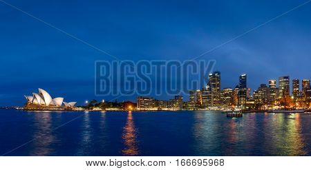 SYDNEY AUSTRALIA - OCTOBER 16 2016: Panorama of Sydney downtown Circular Quay and opera house at night.