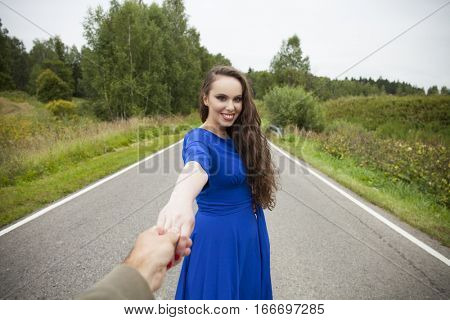 Follow me, Beautiful sexy young woman holds the hand