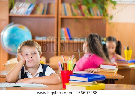 Schoolchildren In Classroom At School