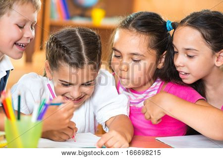 Group Of Cute Schoolchildren Having Fun In Classroom