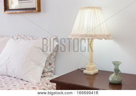 Bedside Table with Lamp on a bright room