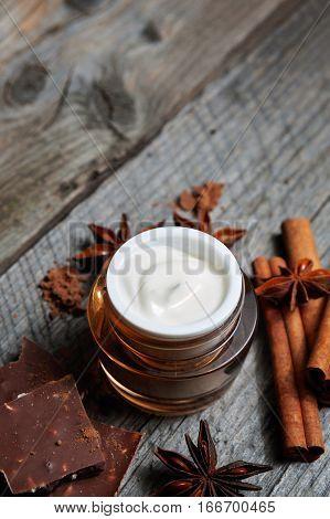 Chocolate Skin Treatment. Cosmetic Jar With Lotion, Cocoa, Anise, Cinnamon Sticks.