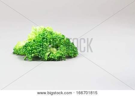 Fresh broccoli on the whte table, Broccoli with copy space