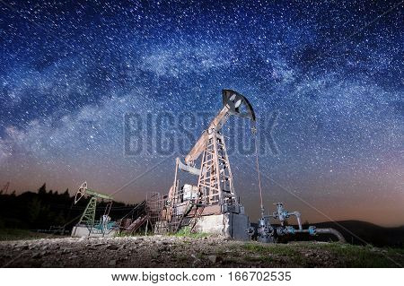 Oil Pumps On The Oil Field In The Night