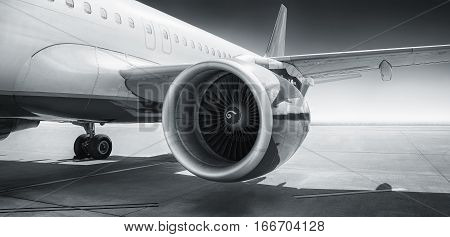 turbine of an airliner on a runway