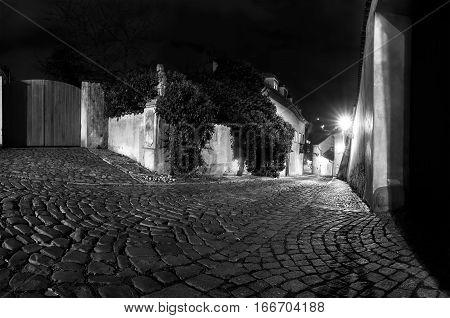 B&W Night time view on castle alley New World Prague Castle Hradcany Czech Republic