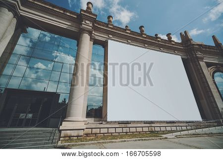 Mock up banner for your advertising on huge facade of building with columns blank big billboard with copy space area for your text message or promotional content on house with panoramic windows