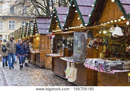 LVIV, UKRAINE - DECEMBER 11, 2016: Christmas holiday market on the central square of Lviv (Market square)