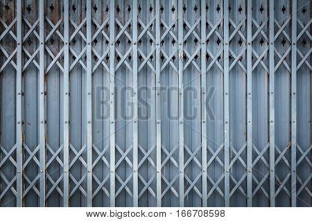 Old steel door texture pattern or steel door background with rusty metal. Grunge retro vintage of steel door for design. Dark edged.