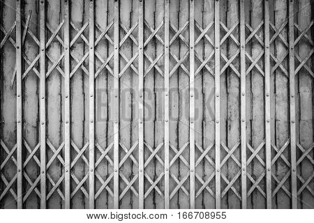Old steel door texture pattern or steel door background with rusty metal. Grunge retro vintage of steel door for design. Black and white. Dark edged.