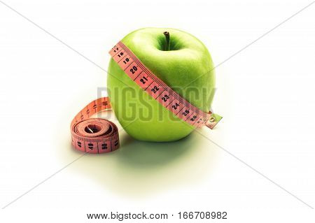 Green apple with centimeter - losing weight. isolated