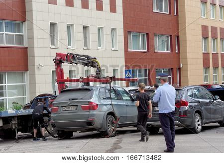 Nizhny Novgorod, Russia. - July 14.2016. The Municipal Tow Truck Evacuates Wrong Parked Car In The M
