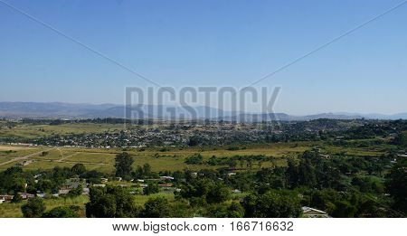 View over the Middleveld in the Kingdom of Swaziland, villages and fertile countryside, in the background the Lubombo Mountains, cloudless sky