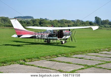 Ocova Slovakia - August 2 2014: Pilot check his small personal airplane before taking off and prepares for the flight