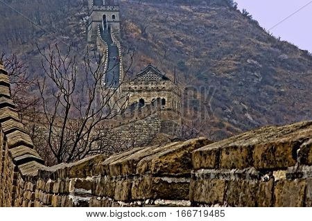 The Great Wall of China in early spring; one of a series of pictures. This image shows two watchtowers in the distance. It has been enhanced with a HRD filter to make the details and colors pop.
