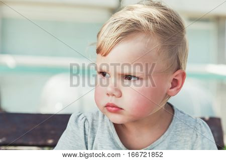 Serious Cute Caucasian Blond Baby Girl