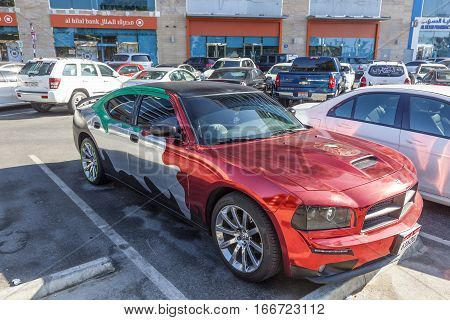 ABU DHABI UAE - DEC 3 2016: Dodge Charger decorated with national colors of the United Arab Emirates in Abu Dhabi