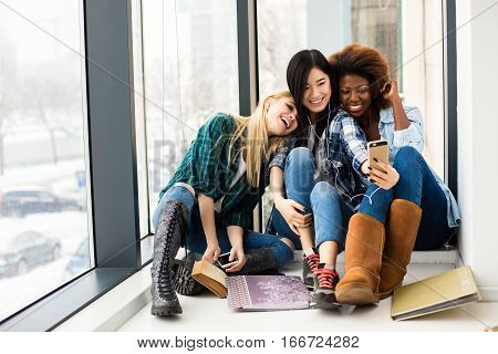 Group Of Three Different Ethnic Girls Having Fun And Studying