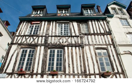 FRANCE ROUEN - AUGUST 11 2012: Typical building facade wooden architecture in timber framing medieval style