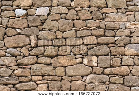 Old stone wall stones fitted together without cement, carved by hand