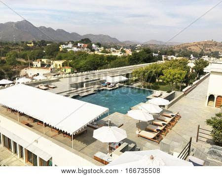 UDAIPUR INDIA - JANUARY 14 2017: RAAS Devigarh Hotel pool. Nestled in the Aravalli Hills of the Udaipur area the 18th century palace has spectacular views of the valley.