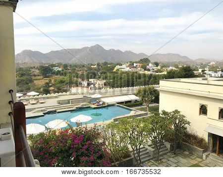 UDAIPUR INDIA - JANUARY 14 2017: RAAS Devigarh Hotel pool. Nestled in the Aravalli Hills of the Udaipur area an 18th century palace has spectacular views of the valley.