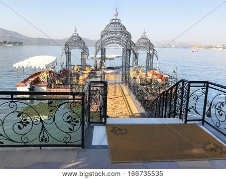 UDAIPUR INDIA - JANUARY 13 2017: Ferry Dock at the Taj Lake Palace Hotel on Lake Pichola. The ferry runs to the City Palace.