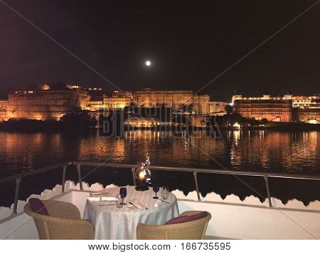 UDAIPUR INDIA - JANUARY 14 2017: City Palace at night. Located on Lake Pichola and built in a flamboyant style is considered the largest of its type in the state of Rajasthan.