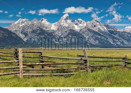 Mountains of Grand Tetons National Park with fence in the foreground.