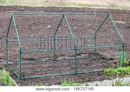 Frame collapsible mini greenhouses installed in the vegetable garden
