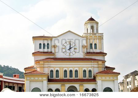 white alcazar with a clock