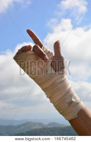 people with wrist pain in an Elastic Bandage exercise fingers with sky background