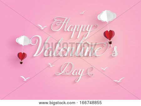 Concept of happy valentine daymessage floating in the air with origami made hot air balloon in a heart shape Paper art and craft style.