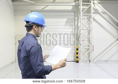 The civil engineer see plant lay-out inside the factory