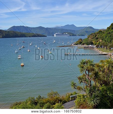 Picton New Zealand - December 26 2016: Massive Luxury Passenger Liner leaves the port of Picton in the marlborough Sound. Waikawa Bay in the foreground.