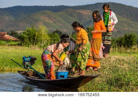 INLE LAKE, MYANMAR - DECEMBER 09, 2016 : local people traveling by boat on the Inle Lake Shan state in Myanmar