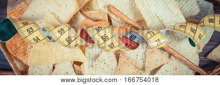 Vintage Photo, Centimeter With Salted Crisps, Cookies And Breadsticks, Unhealthy Food And Slimming