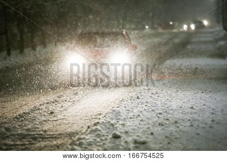Car On Snowy Road