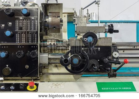 Lathe machine in workshop for cutting material and make thread in heavy industry