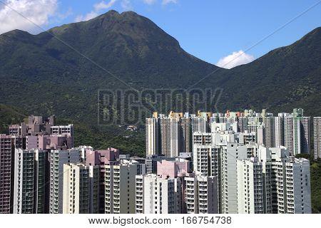 HONG KONG - JUNE 19, 2016: Lantau Peak above Tung Chung city on June 19, 2016 in Hong Kong, China.