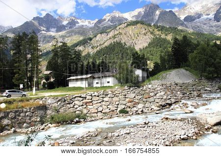 rural scenery and waterfall at the foot of Mont Blanc