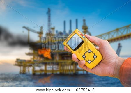 Safety concept of fire in oil and gas petrochemical industry gas detector checking gas leaking before working to prevent fire case.