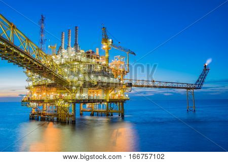Oil and gas processing platform producing oil gas and water sent to onshore refinery and power generation plant