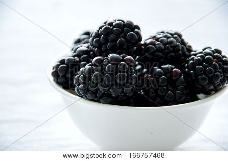 Fresh ripe balckberry in a bowl on a table