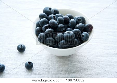 Fresh blueberries in a bowl on whote table